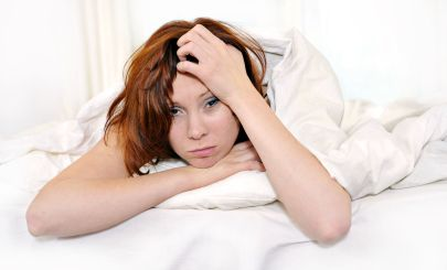 tired-woman-in-bed