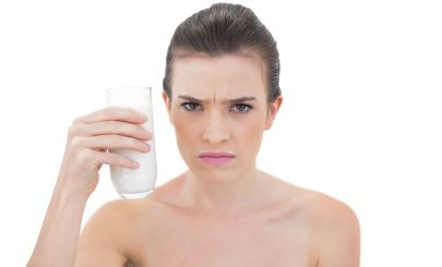 frowning-woman-with-glass-milk