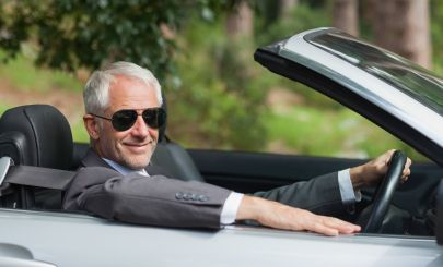 silver-fox-in-convertible-sports-car