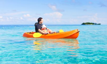 bloke-paddling-kayak-in-turquoise-water