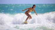 teenage-girl-surfing