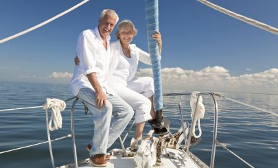 older-couple-gloating-on-yacht